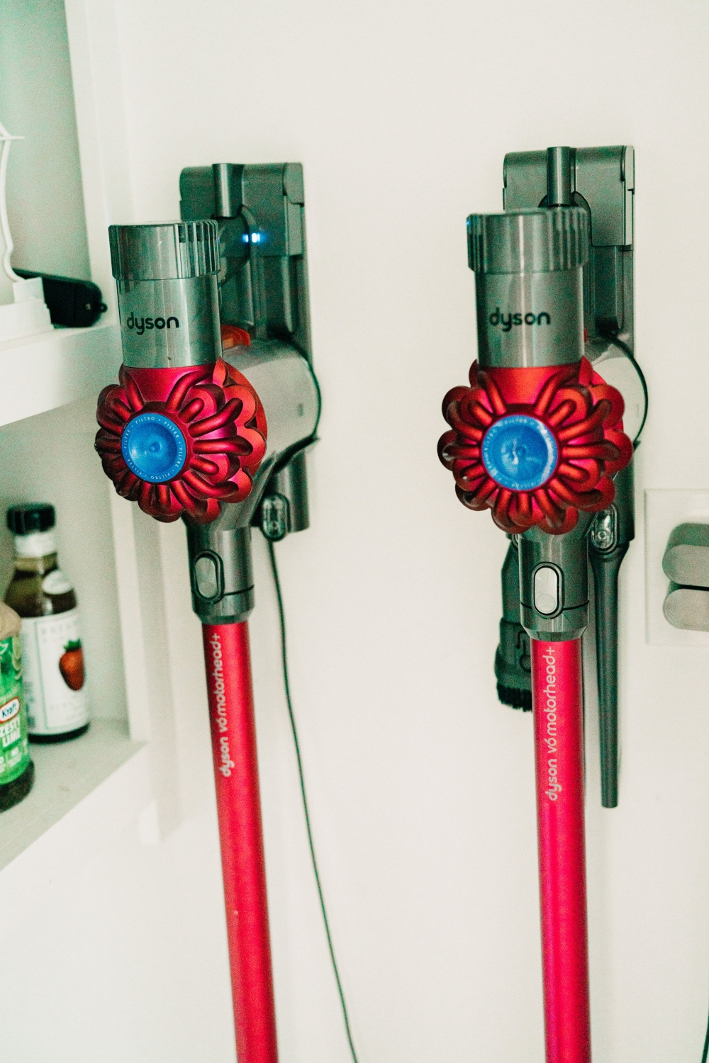 Dyson Vacuums Hanging on The Wall